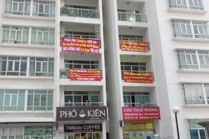 TP.HCM: Cư dân treo băng rôn phản đối ban quản trị tại khu căn hộ New Saigon