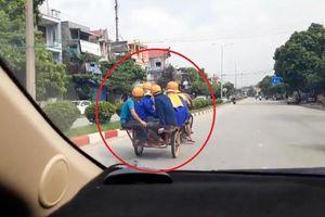 Xe máy kéo ba gác chở 9 người ngồi phía sau