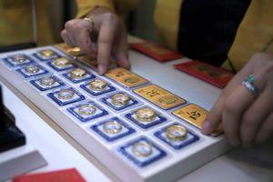 Vàng, USD quay đầu giảm giá
