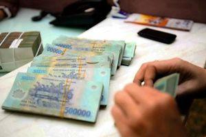 Tiền gửi của các tổ chức kinh tế vào hệ thống ngân hàng bất ngờ tăng trở lại