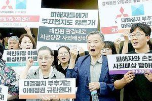 Nhật Bản: Sẽ hành động nếu lợi ích các công ty bị tổn hại