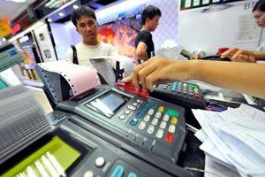Nhiều giao dịch trong chứng khoán, thuế, tài chính bắt buộc phải thanh toán qua ngân hàng