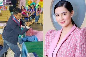 Chồng mỹ nhân Philippines lặng lẽ quay clip cho vợ ở sự kiện