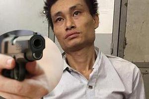 Mang 9.000 viên ma túy dùng súng chống trả Cảnh sát