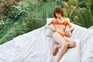 Ngọc Trinh tiếp tục khoe body 'đốt mắt' với bikini màu cam rực rỡ