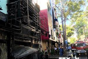 TP.HCM: Giải cứu 2 người trong vụ cháy tại ngôi nhà 4 tầng