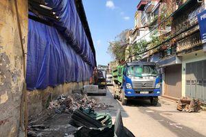 Xây tường gạch, hút hố ga ngăn chặn ô nhiễm tại Công ty Rạng Đông