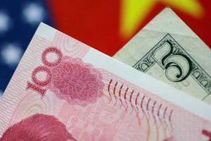 Nhân dân tệ rớt giá so với USD khi Trung Quốc công bố gói kích thích tài chính