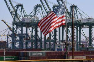 Thương chiến Mỹ - Trung kéo tụt tăng trưởng toàn cầu