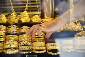 Vàng thế giới giảm giá trong tuần qua do sức hút của đồng USD