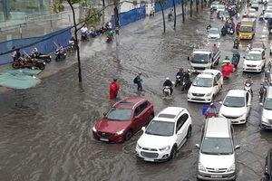Người dân lo nhà thành 'hầm chứa nước' khi nâng đường Nguyễn Hữu Cảnh