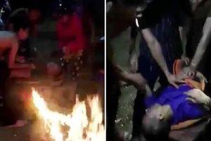 Đốt lửa sưởi ấm, cứu thanh niên bị rơi xuống sông Lam trong đêm tối