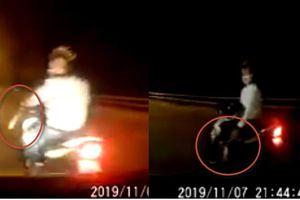 Clip gã tóc bờm ngựa cầm dao đánh võng trước đầu ô tô ở Hải Phòng: Cướp hay xin đểu?