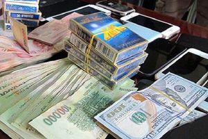 Thua 200 triệu đồng vừa vay, rút súng bắn và cướp 205 triệu đồng ngay trên sới bạc