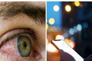 Dùng điện thoại quá lâu có thể vỡ mạch máu mắt