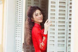 Ngắm vẻ đẹp thiếu nữ của á hậu Lý Kim Thảo trong áo dài tết