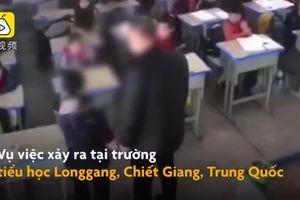Clip: Phẫn nộ thầy giáo hành hung, dốc ngược học sinh tiểu học