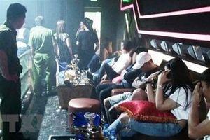 'Dân chơi' tàng trữ ma túy, súng đạn trong quán bar