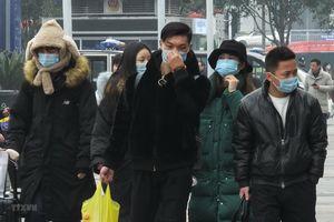 Nhiều địa phương Trung Quốc yêu cầu bắt buộc đeo khẩu trang