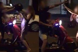 Chồng đánh vợ giữa đường vì 'đi nhậu không xin phép'