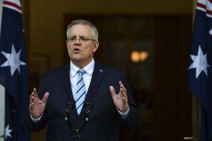Australia khuyên người nước ngoài về nước nếu không thể tự lo ngừa Covid-19