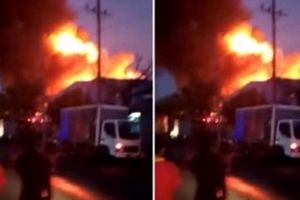 Phá cửa cuốn, cứu 4 người mắc kẹt trong đám cháy