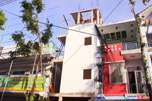 Chủ công trình xây dựng làm nứt nhà hàng xóm phải bồi thường gần 900 triệu đồng