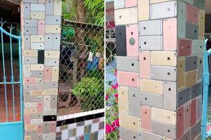 Trầm trồ trước ngôi nhà dùng hàng trăm chiếc iPhone để ốp tường, dát đầy 2 bên cổng