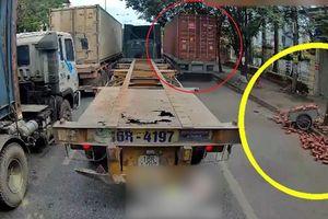 Tài xế xe container bỏ mặc nạn nhân sau va chạm