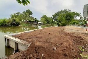Doanh nghiệp ngang nhiên kè bê tông lấn chiếm dòng kênh