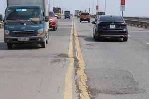 Cấm ô tô trên cầu Thăng Long từ cuối tháng 7 để sửa chữa mặt cầu
