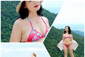 NSND Thu Quế khoe da trắng nõn với bikini ở tuổi 51