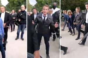 Tổng thống Macron bị người biểu tình bao vây khi đi bộ cùng vợ