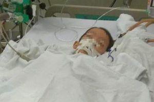 Bé trai 7 tuổi nguy kịch sau ca mổ lấy đinh nẹp ở tay
