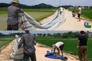 Người dân dỡ bỏ lều bạt, thông xe vào khu xử lý chất thải Nam Sơn