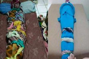 Cảnh sát Indonesia điều tra vụ dụ dỗ hàng loạt sinh viên bọc người như xác ướp