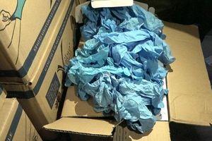 TP.HCM: Phát hiện gần 5.000 thùng carton chứa găng tay y tế giả