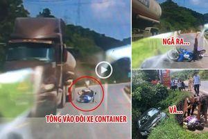 Camera giao thông: Tông vào đuôi xe container, nữ sinh ngã văng rồi bị xế hộp chèn qua người