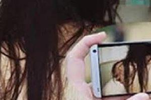 Tống tiền cô gái khoe ngực trên mạng