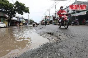 Người dân quận 2 mong đường Lương Định Của sớm được sửa chữa