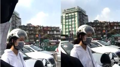 Dân mạng truy tìm cô gái lái xe máy ngủ gật khi dừng đèn đỏ ở Hà Nội