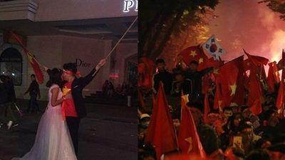 Cặp đôi chụp ảnh cưới trong đêm 'siêu bão' sau khi Việt Nam lên ngôi vương AFF Cup 2018