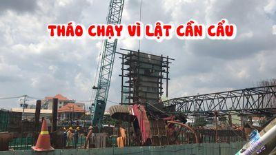 Tháo chạy vì cần cẩu công trình lật đè lên mái nhà dân ở Sài Gòn