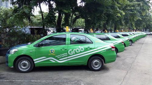 Vụ Grab mua lại Uber: Taxi truyền thống giục Bộ Công Thương sớm ra kết luận