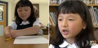 Bé gái không tay chiến thắng cuộc thi viết chữ