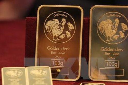 Vàng châu Á vững giá trước thềm cuộc họp của Fed