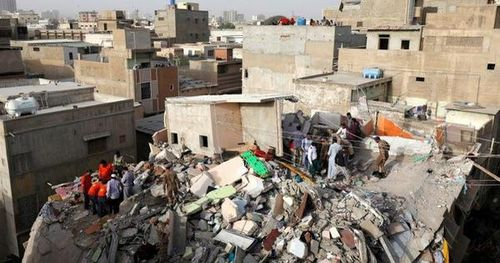 Lén xây thêm tầng, chung cư bị sập vùi chết 14 người