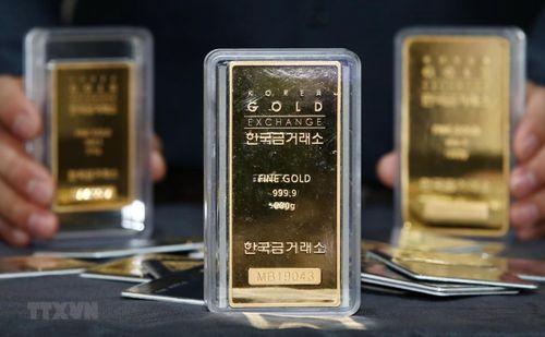 Giá vàng thế giới giảm hơn 1% khi đồng USD tăng trong phiên 19/3