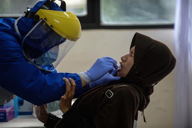 Dịch COVID-19 tại ASEAN hết 26/6: Indonesia, Philippines 'nóng' với trên 1.000 ca nhiễm mới