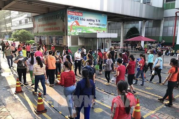 Công nhân Công ty PouYuen Việt Nam ngừng việc được hưởng lương tối thiểu vùng